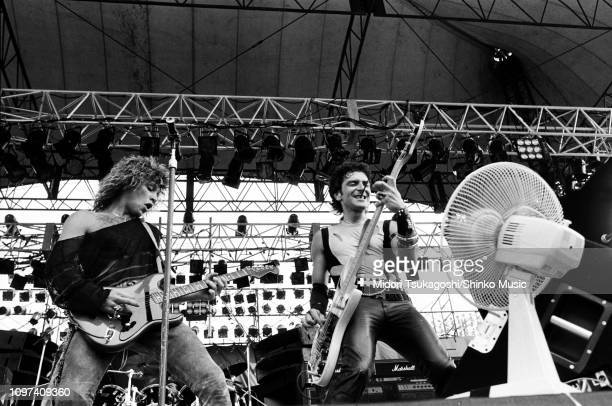 Jon Bon Jovi and Alec John Such of Bon Jovi perform on stage at Nagoya Stadium for Super Rock '84 4th August 1984 Tokyo Japan