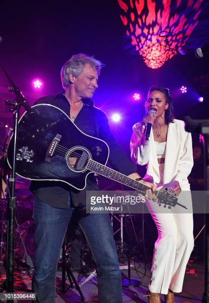 Jon Bon Jovi and Alice Smith perform onstage during Apollo in the Hamptons 2018 Hosted by Ronald O Perelman at The Creeks on August 11 2018 in East...