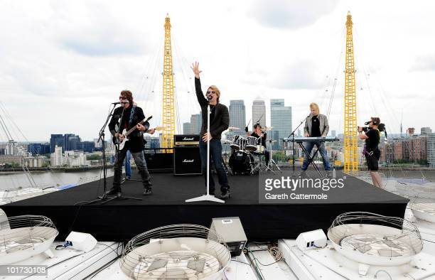 Jon Bon Jovi and Bon Jovi band members perform on the roof of the O2 Arena on June 7, 2010 in Greenwich, London, England. Bon Jovi kick off their 12...