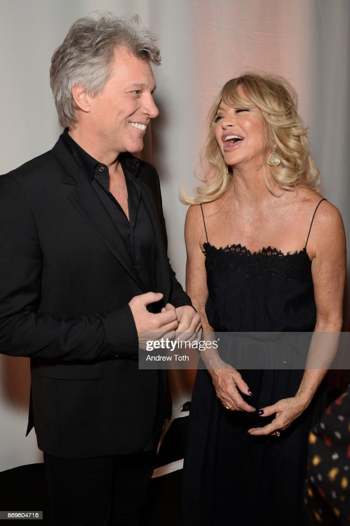 Jon Bon Jovi and Goldie Hawn laugh backstage at the Samsung annual charity gala 2017 at Skylight Clarkson Sq on November 2, 2017 in New York City.