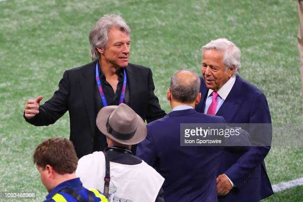 Jon Bon Jovi and New England Patriots owner Bob Kraft and Jonathan Kraft on the field prior to Super Bowl LIII between the Los Angeles Rams and the...