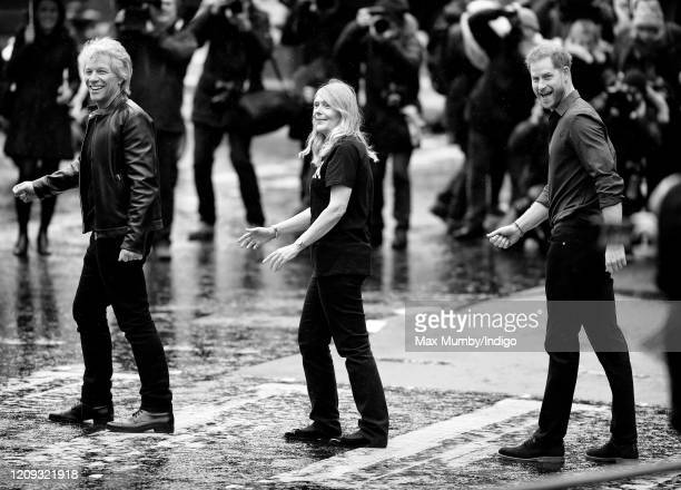 Jon Bon Jovi and Prince Harry, Duke of Sussex along with members of the Invictus Games Choir recreate the iconic Beatles 'Abbey Road' album cover...