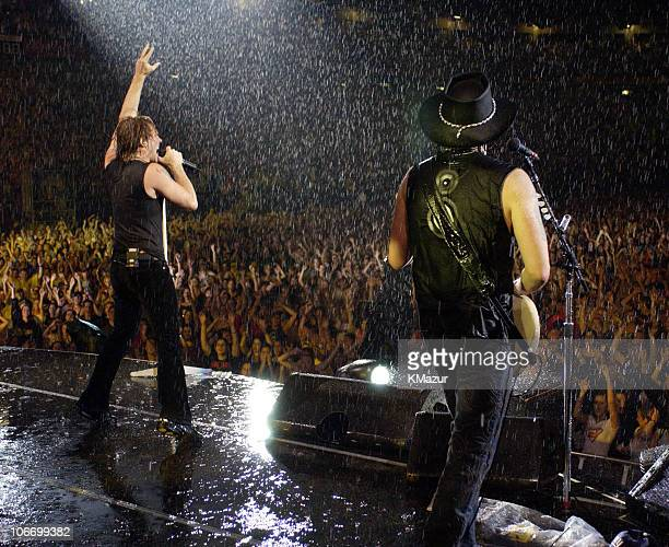 Jon Bon Jovi and Richie Sambora during Bon Jovi's Bounce Tour Live at Giants Stadium on August 7 2003 Show at Giants Stadium in East Rutherford New...