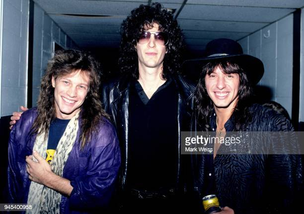 Jon Bon Jovi and Richie Sambora of the rock group Bon Jovi pose for a photo with radio personality Howard Stern backstage at the Nassau Veterans...