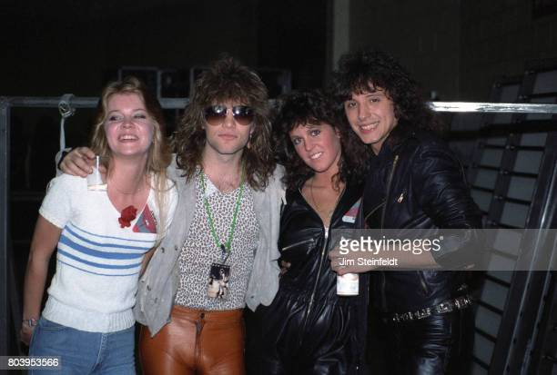 Jon Bon Jovi and Richie Sambora with friends pose for a portrait backstage at the St Paul Civic Center in St Paul Minnesota on May 9 1984