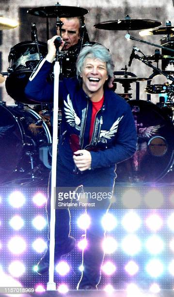 Jon Bon Jovi and Tico Torres of Bon Jovi perform on stage at Anfield on June 19 2019 in Liverpool England