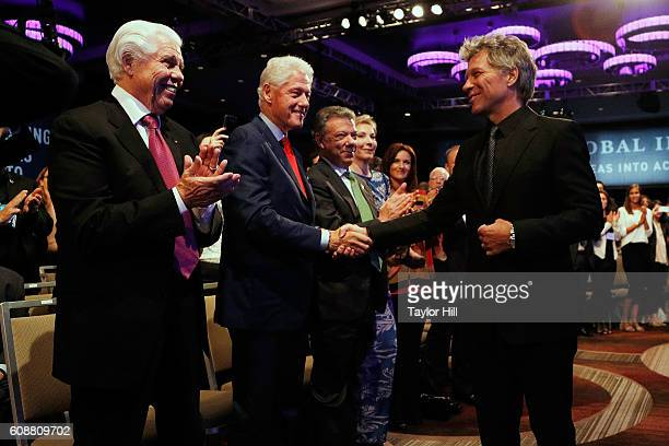 Jon Bon Jovi greats President Juan Manuel Santos Calderon, President Bill Clinton, and Bill Austin during the 2016 Clinton Global Citizen Awards...