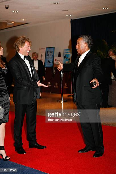 Jon Bon Jovi greets the Reverend Al Sharpton at the White House Correspondents' Association dinner on May 1 2010 in Washington DC The annual dinner...