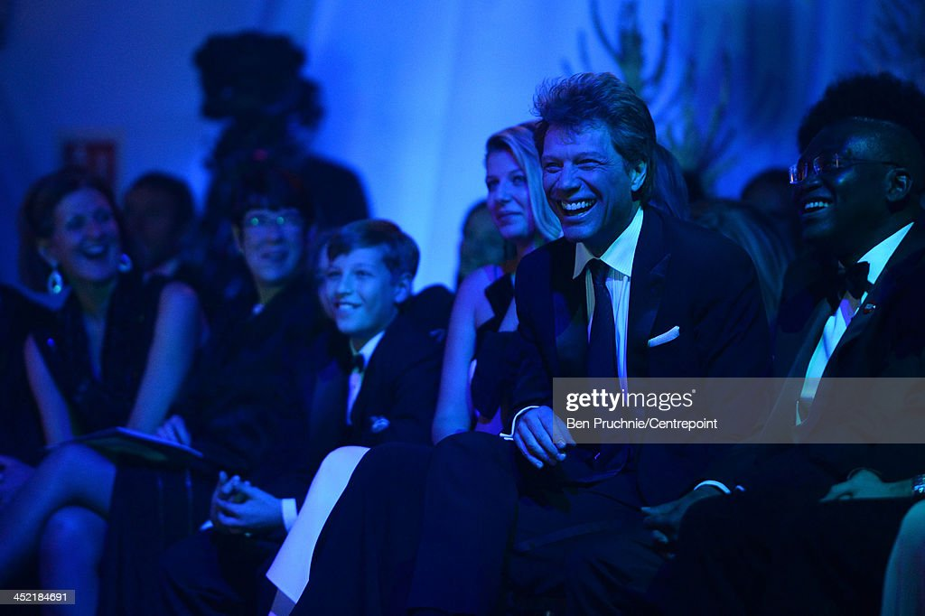 Jon Bon Jovi (2nd R) laughs during the Winter Whites Gala In Aid Of Centrepoint on November 26, 2013 in London, England.