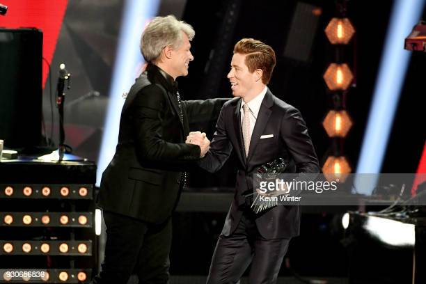 Jon Bon Jovi of Bon Jovi accepts the Icon Award from Shaun White onstage during the 2018 iHeartRadio Music Awards which broadcasted live on TBS TNT...
