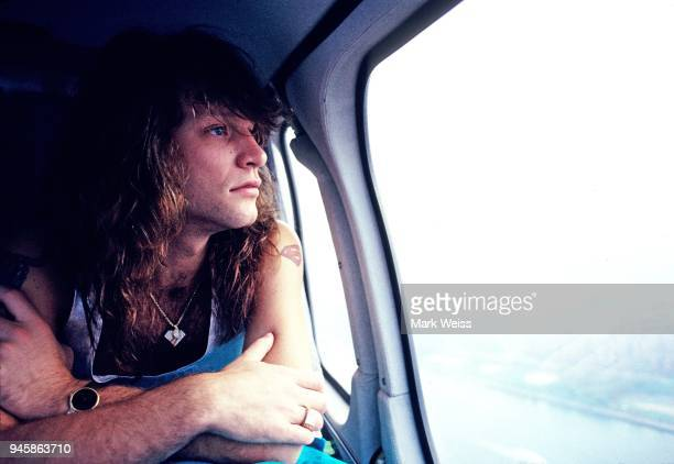 Jon Bon Jovi of the rock band Bon Jovi looks out the window of a helicopter in August 1989