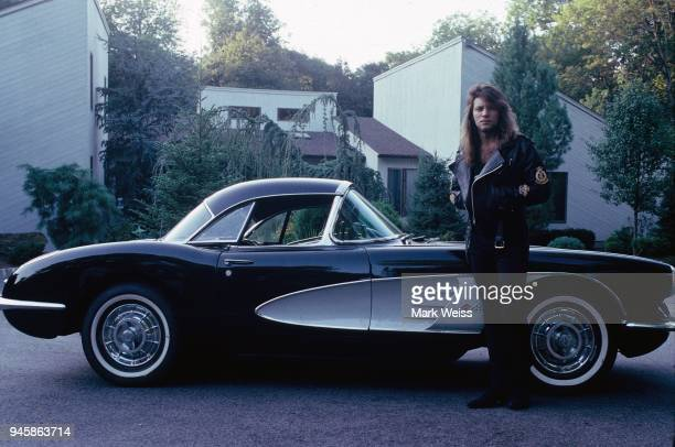 Jon Bon Jovi of the rock group Bon Jovi poses at home in New Jersey with his 1958 Corvette in September 1988 in Rumson, New Jersey.