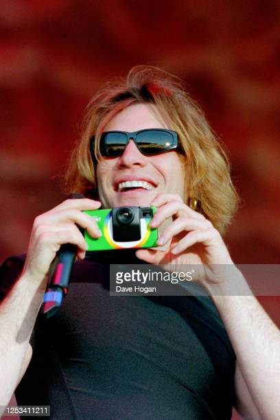 Jon Bon Jovi on stage with a disposable camera on June 23rd 1995