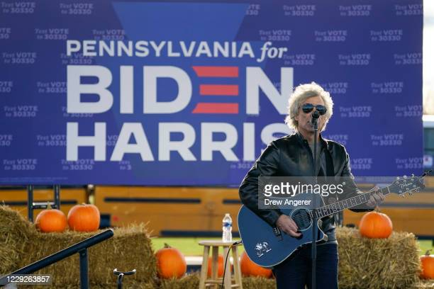 Jon Bon Jovi performs during a a drive-in campaign rally for Democratic presidential nominee Joe Biden at Dallas High School on October 24, 2020 in...