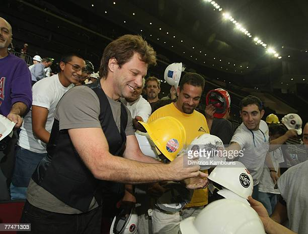 Jon Bon Jovi signs autographs for union workers that helped construct the Prudential Center during the Bon Jovi Rehearsals At The New Prudential...