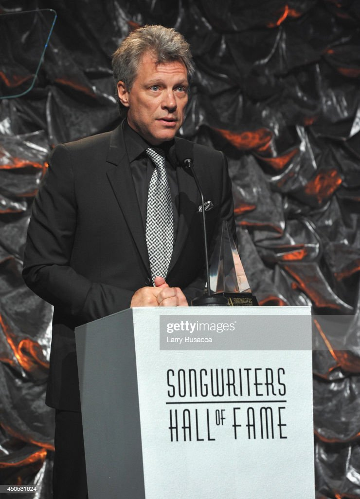 Jon Bon Jovi speaks onstage at the Songwriters Hall of Fame 45th Annual Induction and Awards at Marriott Marquis Theater on June 12, 2014 in New York City.