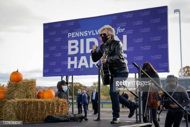 Jon Bon Jovi takes the stage to perform during a a drive-in campaign rally for Democratic presidential nominee Joe Biden at Dallas High School on...