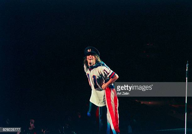 Jon Bon Jovi wearing the flag as a cape in performance circa 1990 New York