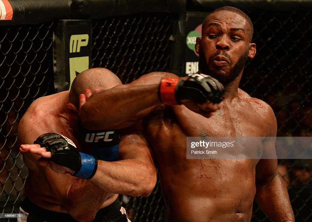 Jon 'Bones' Jones elbows Glover Teixeira in their light heavyweight championship bout during the UFC 172 event at the Baltimore Arena on April 26, 2014 in Baltimore, Maryland.