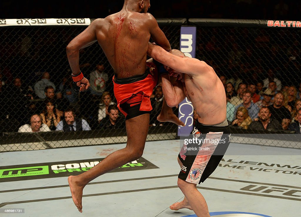 Jon 'Bones' Jones lands a flying knee against Glover Teixeira in their light heavyweight championship bout during the UFC 172 event at the Baltimore Arena on April 26, 2014 in Baltimore, Maryland.
