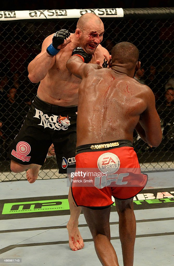 Jon 'Bones' Jones punches Glover Teixeira in their light heavyweight championship bout during the UFC 172 event at the Baltimore Arena on April 26, 2014 in Baltimore, Maryland.