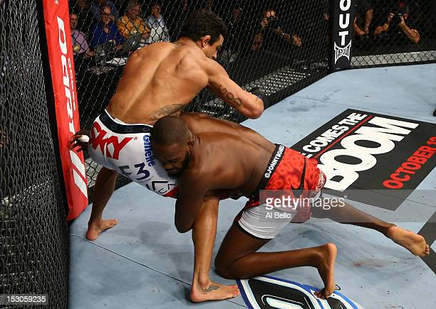 """Jon """"Bones"""" Jones shoots for a takedown against Vitor Belfort during their light heavyweight championship bout at UFC 152 inside Air Canada Centre on..."""