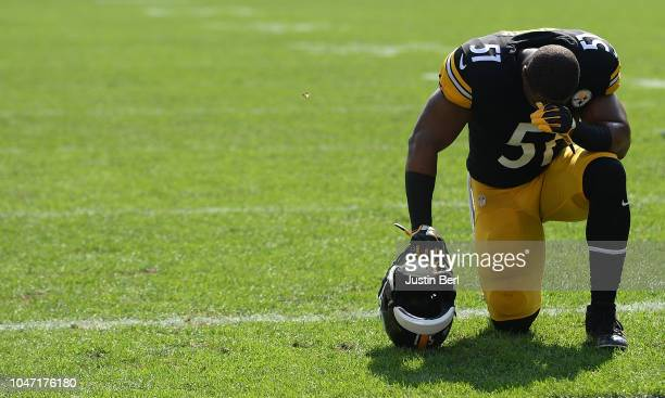 Jon Bostic of the Pittsburgh Steelers kneels in the end zone before the start of the game against the Atlanta Falcons at Heinz Field on October 7...