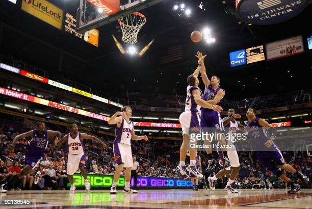 Jon Brockman of the Sacramento Kings puts up a shot over Taylor Griffin of the Phoenix Suns during the NBA preseason game at US Airways Center on...