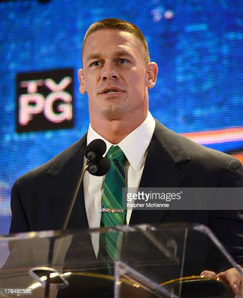 Jon Cena arrives to the WWE SummerSlam Press Conference at Beverly Hills Hotel on August 13 2013 in Beverly Hills California
