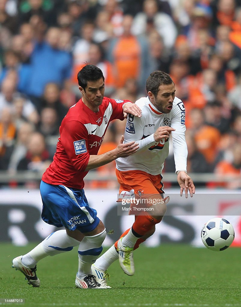 Jon Challinor of York City tangles with Robbie Willmott of Luton Town during the Blue Square Bet Premier League Play Off Final at Wembley Stadium on May 20, 2012 in London, England.