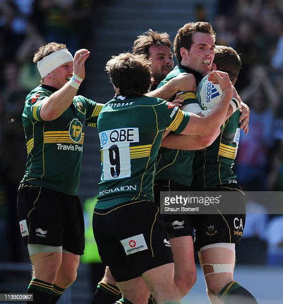 Jon Clarke of Northampton Saints is congratulated by team-mates after scoring during the Heineken Cup Semi-Final match between Northampton Saints and...