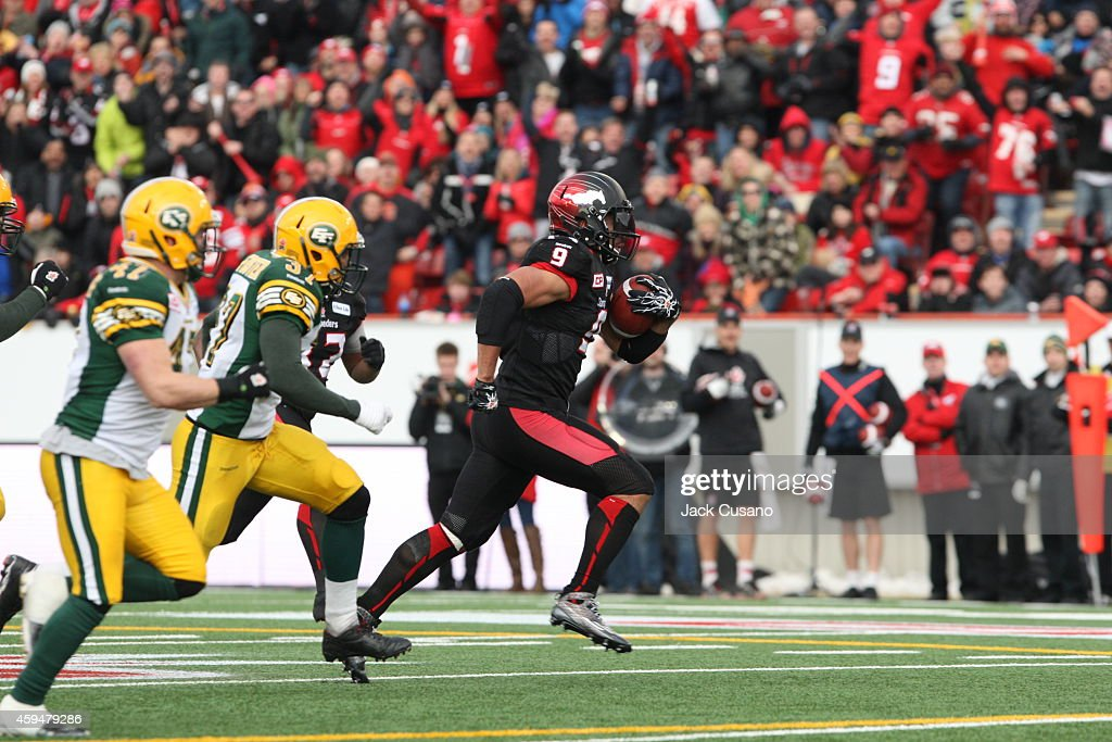 Jon Cornish #9 of the Calgary Stampeders runs for a touchdown against the Edmonton Eskimos during the divisional finals at McMahon Stadium on November 23, 2014 in Calgary, Alberta, Canada.