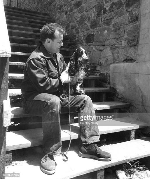JUN 18 1958 Jon Crain holds his English cocker spaniel Matteo on the steps of the Central City Opera house