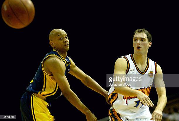 Jon Croft of the Razorbacks gets a pass around Derek Rucker of the Bullets during the NBL match between the Brisbane Bullets and the West Sydney...