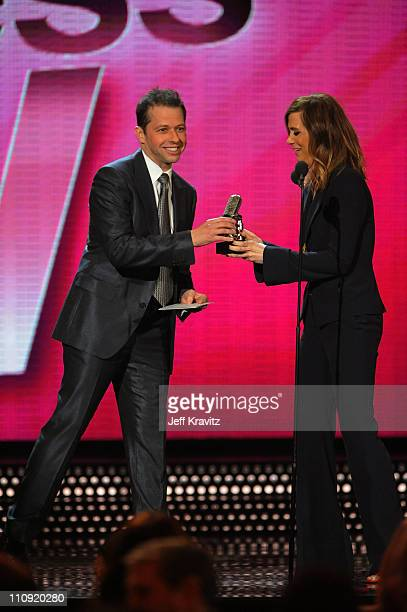 Jon Cryer and Kristin Wiig speak onstage at the First Annual Comedy Awards at Hammerstein Ballroom on March 26, 2011 in New York City.