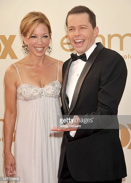 Jon Cryer and Lisa Joyner arrive at the Academy of Television Arts Sciences 63rd Primetime Emmy Awards at Nokia Theatre LA Live on September 18 2011...