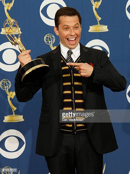 Jon Cryer poses with his award for Best Supporting Actor in a Comedy Series for Two and a Half Men in the press room at the 61st Primetime Emmy...