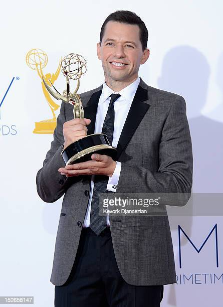 Jon Cryer winner of Outstanding Lead Actor in a Comedy Series poses in the press room during the 64th Annual Primetime Emmy Awards at Nokia Theatre...