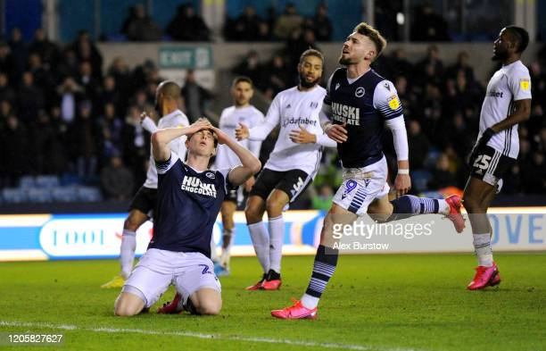 Jon Dadi Bodvarsson and Tom Bradshaw of Millwall react during the Sky Bet Championship match between Millwall and Fulham at The Den on February 12...