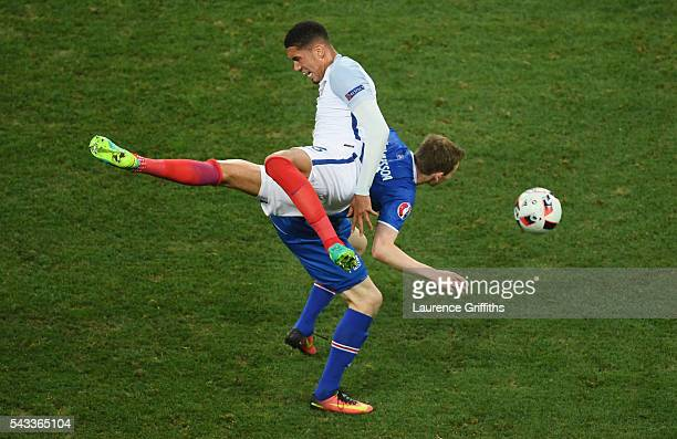 Jon Dadi Bodvarsson of Iceland and Chris Smalling of England compete for the ball during the UEFA EURO 2016 round of 16 match between England and...