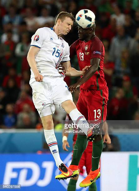 Jon Dadi Bodvarsson of Iceland and Danilo of Portugal in action during the UEFA EURO 2016 Group F match between Portugal and Iceland at Stade...