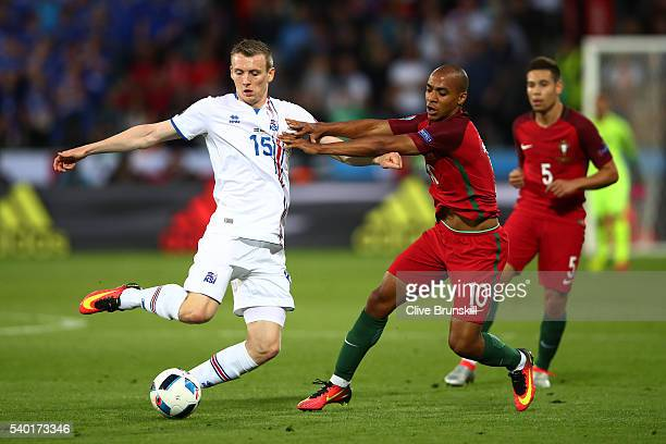 Jon Dadi Bodvarsson of Iceland and Joao Mario of Portugal compete for the ball during the UEFA EURO 2016 Group F match between Portugal and Iceland...