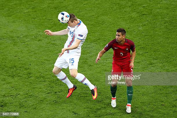 Jon Dadi Bodvarsson of Iceland and Raphael Guerreiro of Portugal compete for the ball during the UEFA EURO 2016 Group F match between Portugal and...