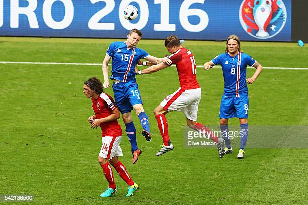 Jon Dadi Bodvarsson of Iceland and Sebastian Proedl of Austria challenge for the ball during the UEFA EURO 2016 Group F match between Iceland and...
