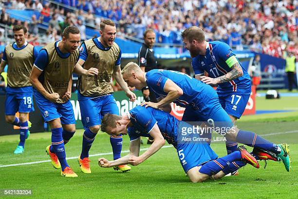 Jon Dadi Bodvarsson of Iceland celebrates scoring his team's first goal with his teammates during the UEFA EURO 2016 Group F match between Iceland...