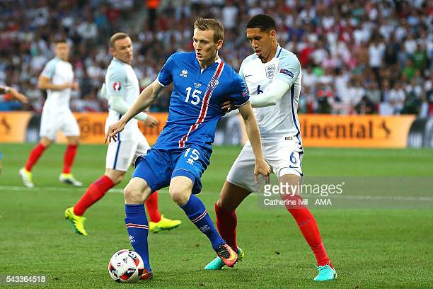 Jon Dadi Bodvarsson of Iceland competes with Chris Smalling of England during the UEFA Euro 2016 Round of 16 match between England and Iceland at...