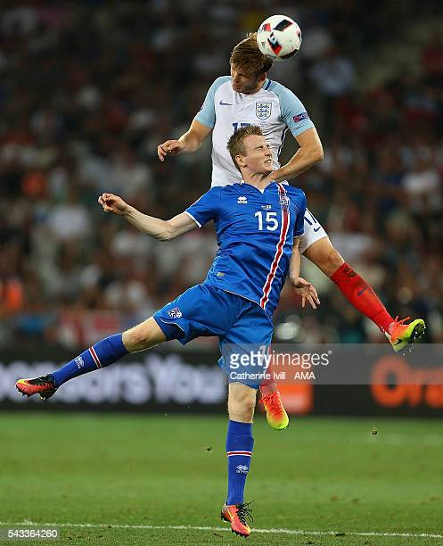 Jon Dadi Bodvarsson of Iceland competes with Eric Dier of England during the UEFA Euro 2016 Round of 16 match between England and Iceland at Allianz...
