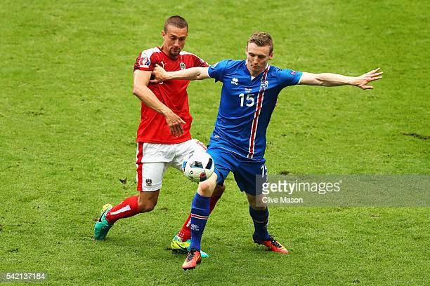 Jon Dadi Bodvarsson of Iceland holds off the challenge of Stefan Ilsanker of Austria during the UEFA EURO 2016 Group F match between Iceland and...