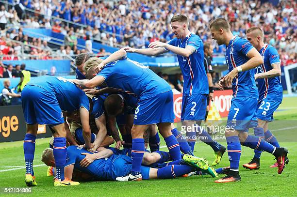 Jon Dadi Bodvarsson of Iceland is mobbed by his teammates after scoring his team's first goal during the UEFA EURO 2016 Group F match between Iceland...