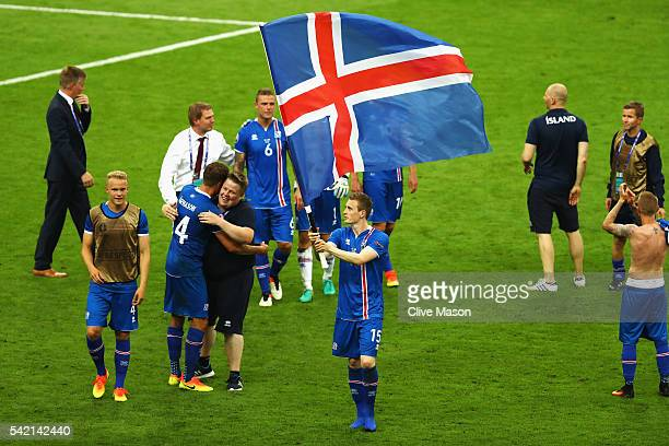 Jon Dadi Bodvarsson of Iceland leads celebrations with his national flag after victory in the UEFA EURO 2016 Group F match between Iceland and...